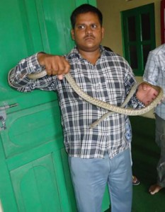 Rescued Rat Snake with our Rescuer Mr.R.K. Mandal.