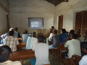 Community People Watching Documentary on Climate Change Effects in Nepal